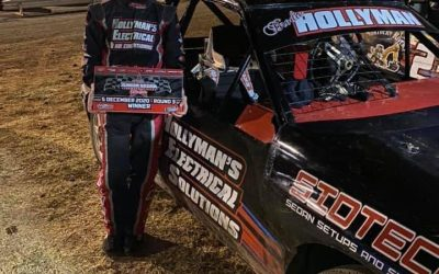 HOLLYMAN WINS ROUND TWO